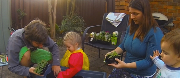 River and Asher build an herb garden