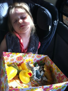 One very satisfied three-year old on the way home from her party at the zoo.